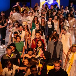Group of students on stage at Threads Fashion Show