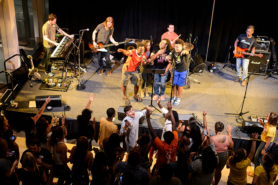 Aerial view of students performing on stage and singing along to the music
